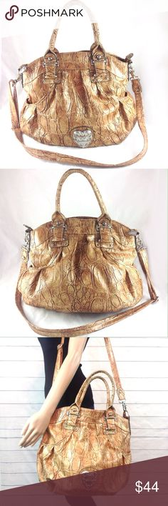 """Kathy Van Zeeland Amazing Gold Bag Excellent condition. No issues outside and clean inside. Large gold faux leather KVZ handbag. Comes with adjustable long strap. Inside wall zip and slip pockets. 15 x 13 x 5"""".     🔹Ask all questions before you purchase!  🔹No trades or holds, but I happily consider offers via the Offer Button! 🔹Bundle for best prices or ask for a custom bundle! Kathy Van Zeeland Bags Shoulder Bags"""