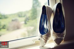 Jessica + Taylor's wedding at Lenora's Legacy. Bride's shoes in a window sill.