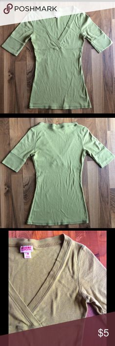 "Mossimo Green Fitted Tee size M Mossimo Supply Co. Green Short Sleeve t-shirt. With its cute crossover front, elbow length sleeves, and vintage soft feel, this adorable step-up from the classic tee will have you trendy *and* comfy with one quick pull over your head. Measurements (taken flat, doubled for bust) : 25"" long, 28"" bust. Questions? Feel free to ask! Mossimo Supply Co. Tops Tees - Short Sleeve"