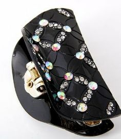 """Gorgeous Black Hair Claw with Genuine Austrian Crystals by Private Label. $13.99. Black clip covered with shimmering Austrian crystals. High-quality polished acrylic for a glossy, ceramic-finish look. Closely set interlocking teeth with rounded edges hold hair tight and secure. Lead and nickel free. The ideal combination of refined elegance and modern bling, this clip can transform any bad hair day into a beautiful do!    This clip measures 3.25"""" L x 1.5"""" W x 1.75"""" H.  T..."""