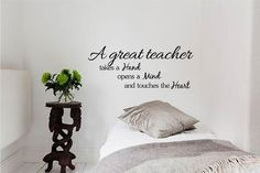A Great Teacher Takes a Hand Opens a Mind and Touches the Heart 22x9 Inches Symbol Matte Black Vinyl Silhouette Keypad Track Pad Decal Window Wall Quotes Sayings Art Vinyl Decal SSC inc. http://www.amazon.com/dp/B00LEVQ77Y/ref=cm_sw_r_pi_dp_I9GUtb0N6J0DYQ08