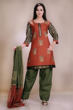 Cotton lined top with all-over chicken work and traditional block printing motifs, All over resham embroidery on sleeves. Contrast cotton salwar & shaded dupatta with block printing
