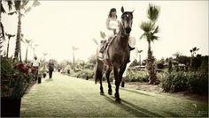 Pina arrives to her wedding at Flora Farm on horseback.