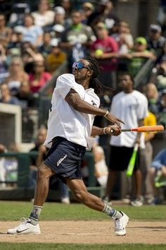 Seattle Seahawks cornerback Richard Sherman hits a home run during the Richard Sherman Celebrity Softball Game on Sunday at Cheney Stadium in Tacoma.