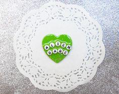 slime green 'ALIEN BABE' ufo glitter heart brooch  by cryybaby, £3.00