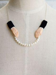 Hairy sock / Ruta Kiskyte Hand holding peals necklace
