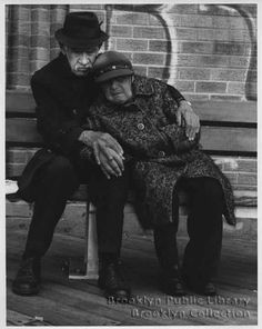Old couple sitting on boardwalk