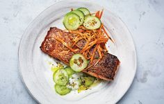 The crisp-skinned salmon is warmed up with spices and the sweetness of carrots. Then it's cooled down with one of the most refreshing combinations of all time: cucumbers and yogurt.