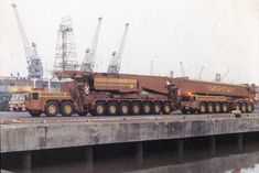 The colour photo on the front cover for the Hewden Stuart AMK 400 speck sheet / duty chart A re - edit from a previous posting Train Truck, Road Train, Trucks And Girls, Big Trucks, Oil Platform, Cement Mixers, Oil Tanker, Engin, Heavy Truck