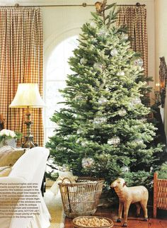 Traditional Home    As I mentioned in my last post, I went with a bit of a muted and natural color scheme with our Christmas decor this y...