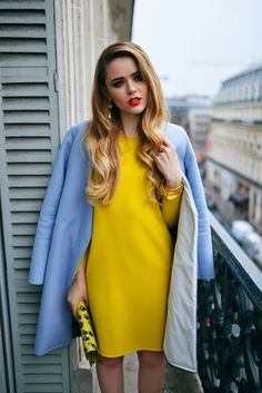 yellow dress and blue coat