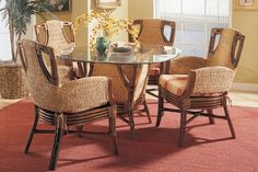 In a modern combination of tropical materials, the Hazelton dining chair creates a pleasing presence for gathering around the table for family meals or entertaining at any time of day. Dining Arm Chair, Dining Table, Wicker Furniture, Master Bedrooms, Home Look, Furnitures, Family Meals, Rattan, Apron