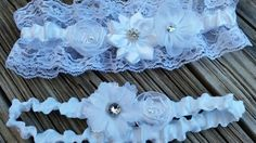 "Wedding garter belt / wedding garter set - white lace wedding garter has a blue bow hidden on the inside of the keep garter for the ""something blue"" wedding tradition.  JessWeddings.org"