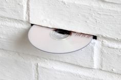 DVD within wall gap