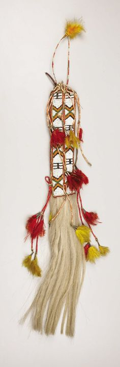 A SIOUX BEADED HIDE HAIR DROP. . c. 1910. ... American Indian | Lot #77135 | Heritage Auctions