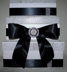 """A classic Wedding Card Reception Box - beautiful 3 tier box with """"bling""""and black satin ribbon against a white glittered background. A bow cascades down the front with pearl and rhinestone pendant in"""