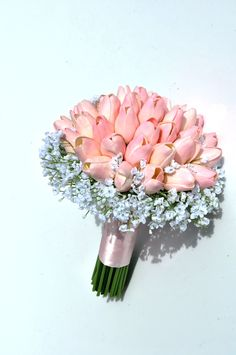 Pink Tulips and Baby's Breath, a simple pair that makes a simple and sophisticated bridal bouquet. Perfect for Spring weddings!