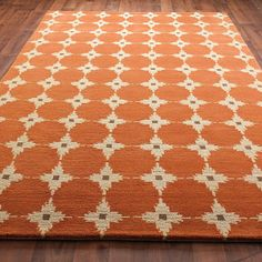 The current rug in our living room.    Tibetan Hand Knot Starburst Rug:  Terracotta