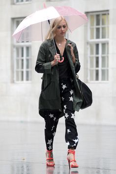 Rain on Cotton's parade? Never. She's all business up top in a windbreaker, but party on the bottom in strappy heels.   - MarieClaire.com