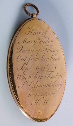Locket of Mary Tudor, Queen of France's hair: 'Hair of Mary Tudor Queen of France cut from her head Sep 6 1784 when her tomb at St Edmundsbury was opened H.W.'