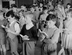 """School Morning Assembly: children singing the hymn """"All Things Bright and Beautiful."""" Once this hymn was sung throughout the British Isles on a daily basis in all types of schools School Memories, My Childhood Memories, Great Memories, 1970s Childhood, School Days, High School, Morning Assembly, This Is Your Life, School Photos"""