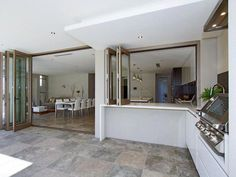 Indoor-outdoor connection, bifold doors, or maybe lots of french doors. Also like how indoor kitchen is connected to outdoor kitchen, but not sure how useful this would be in reality. Love the seamless move from indoor to outdoor cooking! Indoor Outdoor Kitchen, Outdoor Kitchen Design, Outdoor Rooms, Outdoor Cooking, Outdoor Kitchens, Outdoor Ideas, Home Renovation, House Plans, New Homes