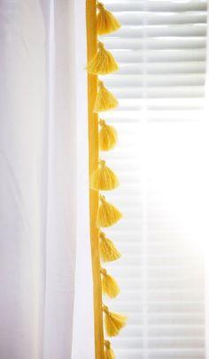 Samantha Rose's Daydream Nursery pom pom trim on curtain