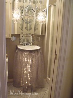 Great way to dress up a pedestal sink before a party, OR for year round decoration. Seer fabric & Christmas lights underneath! Make sure the string lights are LED for safety; won't get hot under there...