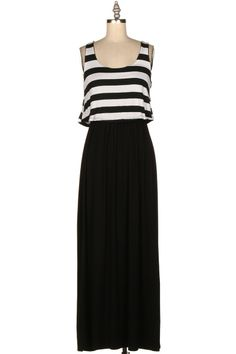 Maxi dresses are a must have staple in every girls closet. This is a color block maxi. The top is back and white stripes and the bottom is navy. Stripes are huge this year which make this number a must have!   95% RAYON. 5% SPANDEX. MADE IN U.S.A.