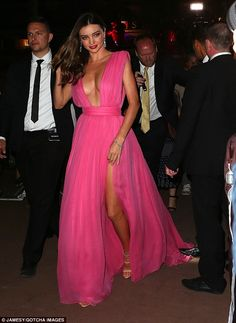 Crisis averted: Miranda Kerr narrowly avoided disaster on Thursday after her dress nearly ...