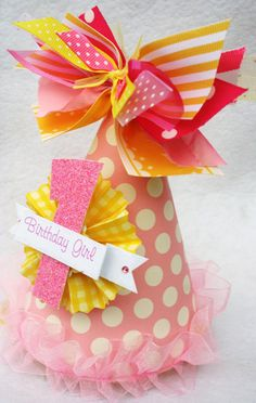 Pink Lemonade party hat in pale pink and sunshine yellow polka dots and stripes. $14.50, via Etsy.