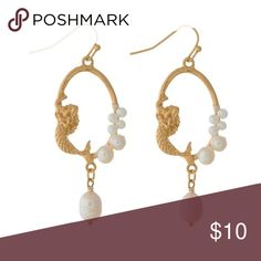 """Gold tone/pearl accent mermaid dangle earrings Super feminine and perfect for that mermaid lover. Matte metal, fishhook earrings with wire wrapped pearl beads and a mermaid accent. 2"""" in length.  ⭐️NEW IN PACKAGING  ⭐️SHIPS SAME/NEXT DAY ⭐️10% DISCOUNT ON BUNDLES OF 3+ ⭐️FREE GIFT W/PURCHASE OVER $40 Chic by the Beach Jewelry Earrings"""