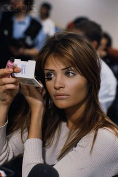 Model Helena Christensen at a fashion show, ca. 1993-1994 (note the Maybelline mascara, frequently recommended by makeup artists).