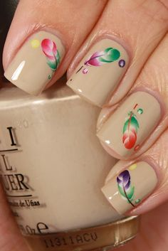 beautiful feather design on nude nails