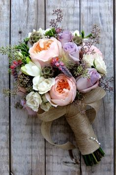 These flowers are pretty. I like the mix of colors used, and the burlap handle adds a depth of texture and an earthy feeling