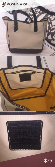 Coach canvas and leather tote. Cream and black class is tote. The canvas has signs of use. I have not tried to professionally clean.  Great bag for office, or travel. Coach Bags Totes