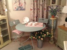A patio set painted in Duck Egg Blue, Chalk Paint by Annie Sloan. On the table top is a vintage tray painted in Antoinette with vintage china.