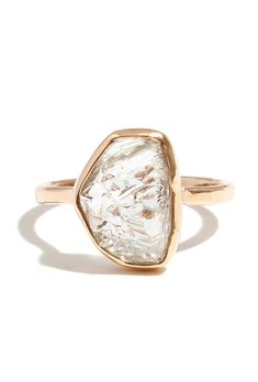 Brides.com: 38 Engagement Rings for the Indie Bride Micropavé triangle and nestled opal diamond pairing, $1,230, WWAKEPhoto: Courtesy of WWAKE