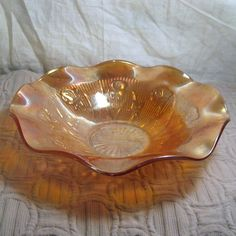 Vintage Fluted Iridescent Marigold Iris Design Carnival Glass Bowl Big Collectible. $30.00, via Etsy.