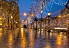 Christmas on the Champs This is one of the most famous streets in the world, so I wanted to do my best to capture it in as romantic a way as possible.  The time of day usually does a lot to affect the mood, and these classical places (especially in Paris) are often better to shoot in the evening or night.  The dusk light is different than the morning light.  And, frankly, it's easier to stay up past sunset than it is to wake up before the sun rises.  I love how these cities put up lights on…