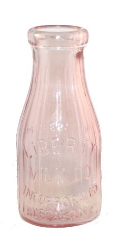 "Art Glass | Pink Milk Bottle Old fashioned MILK BOTTLE pressed and formed in Depression-Style Glass. The milk bottle measures 7.25"" in height and is faithfully reproduced in the old style from extra t"