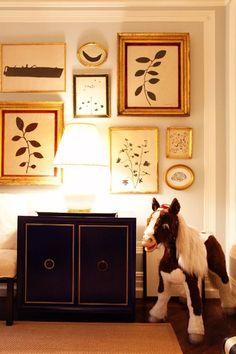 Kate Spade's wall of Hugo Guinness prints - I feel like I need one wall of framed prints....