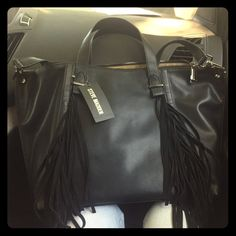 """STEVE MADDEN!! Convertible Tote! NWT NWT Convertible tote with 100% real leather fringe trim! Can be worn as crossbody or over the shoulder!! It has three inside pockets and one outside and is lined. Dimensions are 20""""w x 13""""h x 5""""d. Brand New with tags!!! Perfect condition!✨ Steve Madden Bags Totes"""