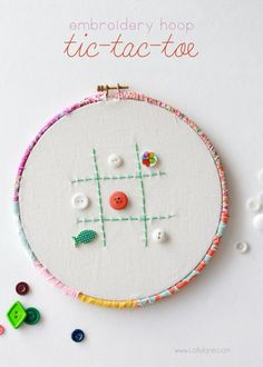 Make an easy Tic-Tac-Toe game from an embroidery hoops + buttons.