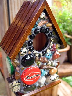 I could do this...pretty stained gems, rocks, and caps glued/glazed to a wooden birdhouse.