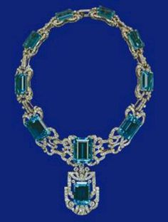Aquamarine and diamond necklace ~~Mappin & Webb, Rio de Janeiro~~ The necklace and a matching pair of earrings were a Coronation gift to The Queen from the President and People of Brazil in 1953. The perfectly matched stones are in diamond and platinum settings. The original detachable pendant of the necklace was mounted in the centre of the tiara by Garrards and has been replaced by a smaller stone, also detachable.