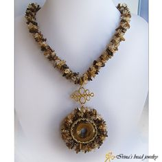 """Necklace Tiger's eye. https://ibj4you.etsythemeshop.com/ Tiger's Eye  necklace made in bead crochet technique, featuring beautiful gemstone pendant. I've used different kinds of Miyuki seed beads and chip Quartz  Tiger's Eye beads.  The beaded crocket rope measure is approximately 46 cm/18.11"""" in length including the clasp. Diameter of this amazing pendant (including gemstone frame) is 5cm/1.97"""""""