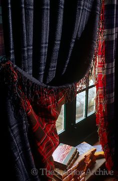 double-sided curtains made of contrasting tartans of dark blue and red
