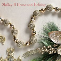 Gold glittered ball garland. Shop Shelley B Home and Holiday for more coordinating ornaments and decorations.
