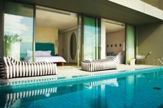 At our Phuket resort, these nine pool suites have large decks. The internal space for all these pool suites includes an indoor dining table for two, and guest powder room. Small Luxury Hotels, Luxury Travel, Hotels And Resorts, Best Hotels, Amazing Hotels, Luxury Resorts, Luxury Accommodation, Destinations, Bar Restaurant
